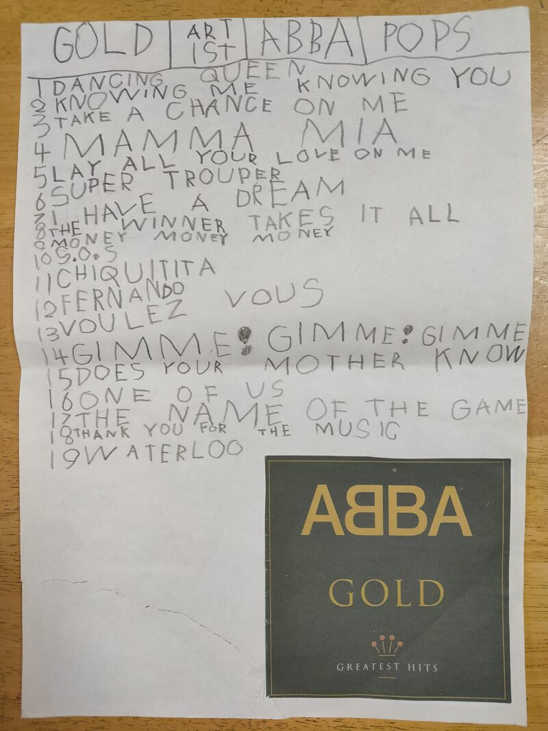 ABBAの曲名を書き写して文字の練習